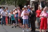 Spectators outside St Peter's Hospice Shop