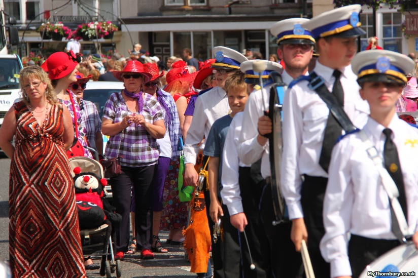 The Dolphin Marching Band, followed by Thornbury's Red Hat Society