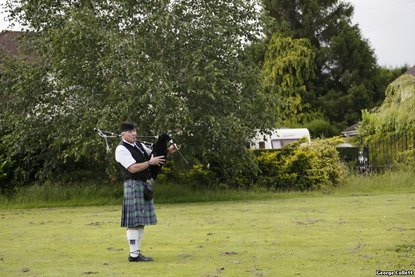 Lone piper before the parade