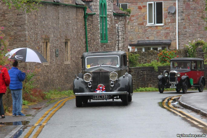 The first of the vintage cars heads up Castle Street